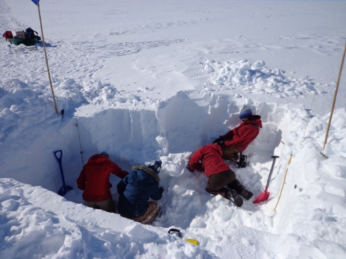 While Kristin and I chip away at our excavations, Ruth and Alden continue to dig back, looking for vertical flow columns...the snow pit is getting larger!