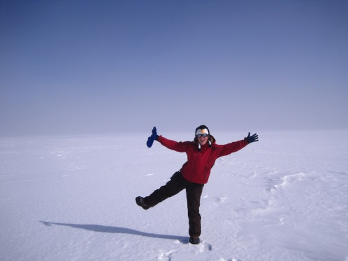 Alden in front of the great white expanse of the Greenland Ice Sheet.