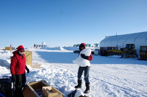 Ruth carrying Hector II - all wrapped up - to the ice core box.