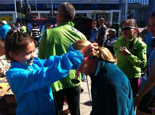 After the race, Alden receives her medal from one of the race organizers!