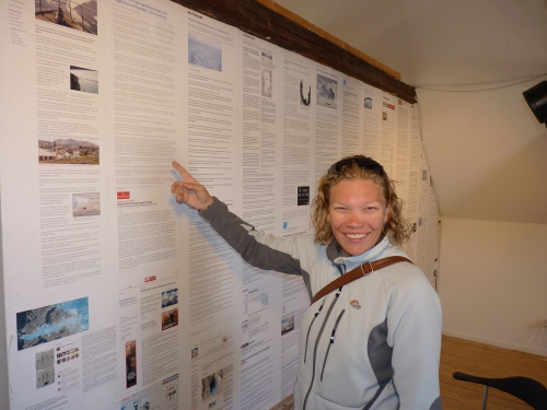 Kristen points out some articles in the museum related to her research!