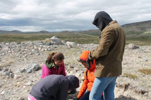 Helping one group with their lichen measurements.