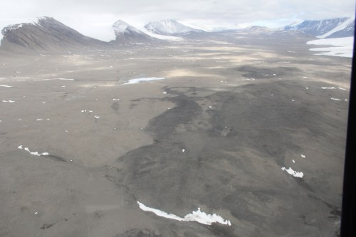 In Taylor Valley, patterns of dark kenyte-rich soil are clearly visible from a helicopter.